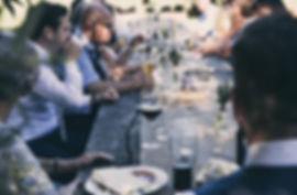 Group-People-Eating-Dinner-Outdoors.jpg