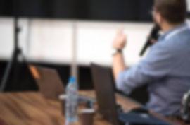 Man-Speaking-Microphone-Conference.jpg