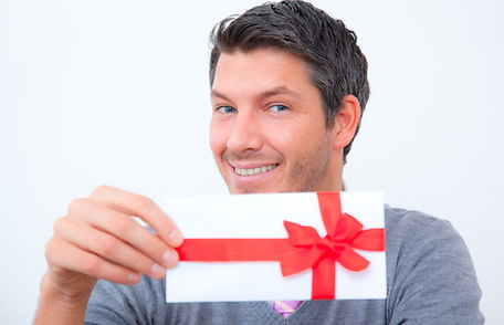 Man holding a gift certificate_