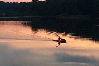 A paddler kayaking across LaDue Reservoi