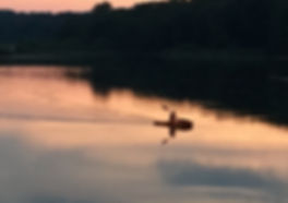 This pictures shows person in  kayak on LaDue Reseroir during a sunset.