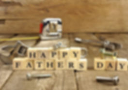 Picture shows small blocks with individual letters that spell out Happy Father's Day.