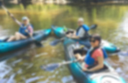A mom and two daughter in solo kayaks_ed
