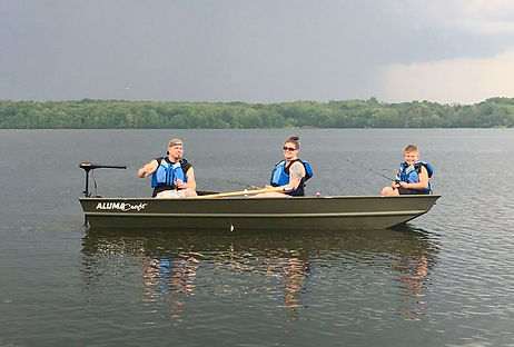 A family in a rental fishing boat with a