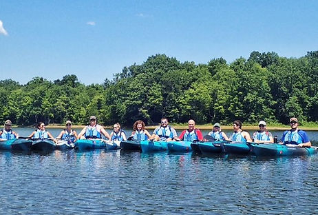 A large group of paddler kayaking on a l