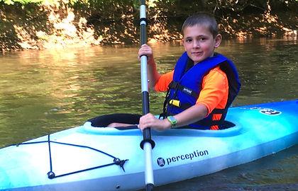 Young paddler in a rental kayak_edited.j
