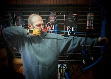 A guy shooting a bow and arrow.jpg