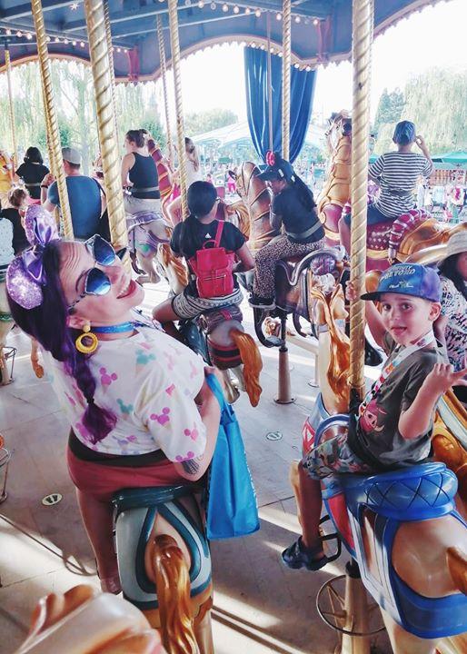 Sarah and Squirrel, mother and child, laughing on the fantasyland carousel at Disneyland paris.