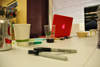 White boards, laptops, coffee