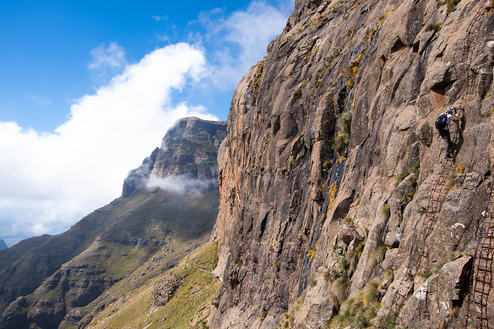 Hanging on a chain ladder on the Chain Ladder hike aka Sentinel Peak, South Africa