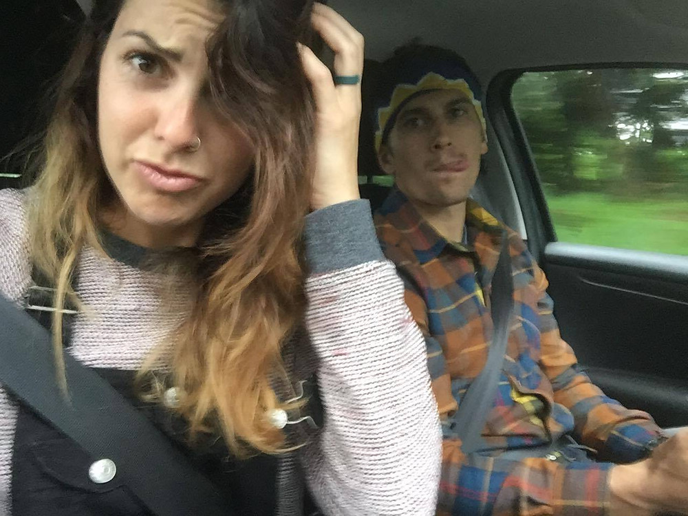 Kate and Chris making faces in the car abroad