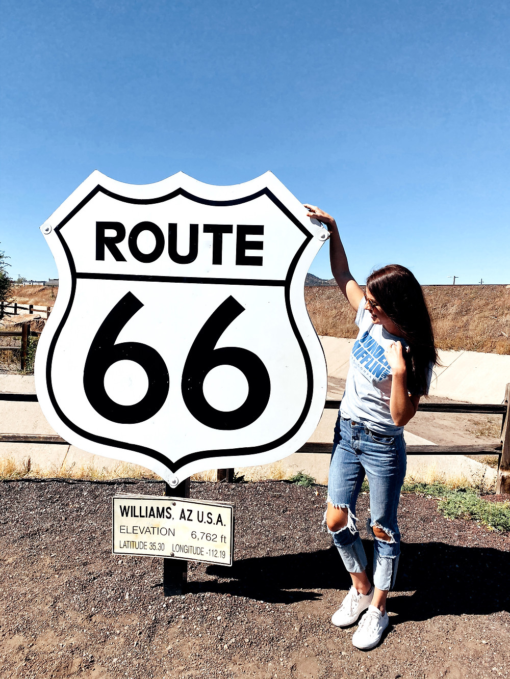 Kate posing with the Route 66 sign in Williams, Arizona