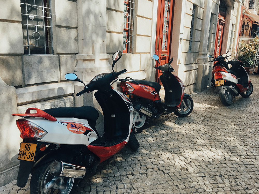 Parking scooters on small cobblestone roads