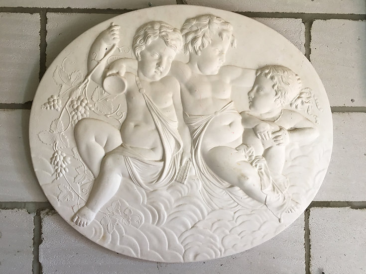 ornate solid plaster cast plaque with three cherubs