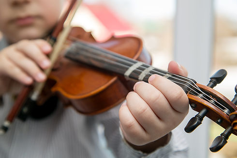 child hands playing the violin.jpg