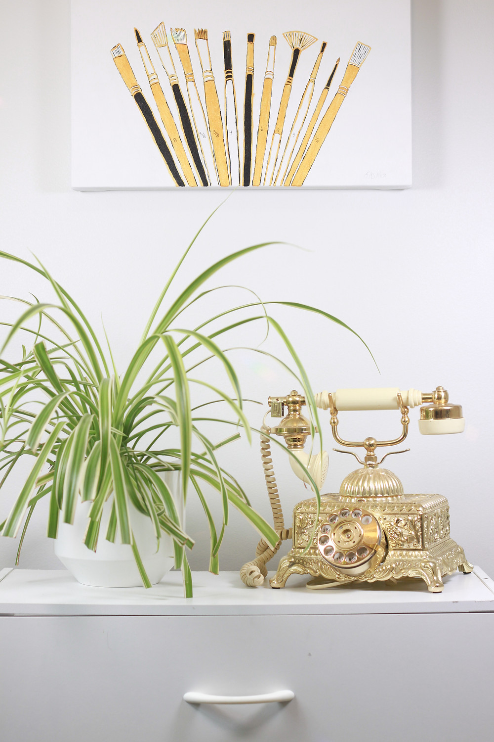 plant, spider plant, paint brushes, acrylic, painting, gold, antique phone, phone, antique, office, art studio, studio, work space, white, clean, elegant, interior design, creative space, Saskatoon, artwork, Kas Rea, Kas Rea Visual Arts, drawer, classy