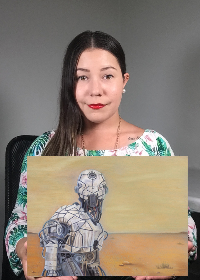 A woman artist holding up a drawing of a robot