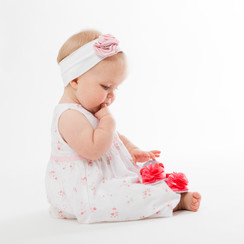 Babyfoto Was sind denn die roten Dinger?
