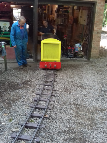 Merlin slowly exiting the truck shed onto the new track