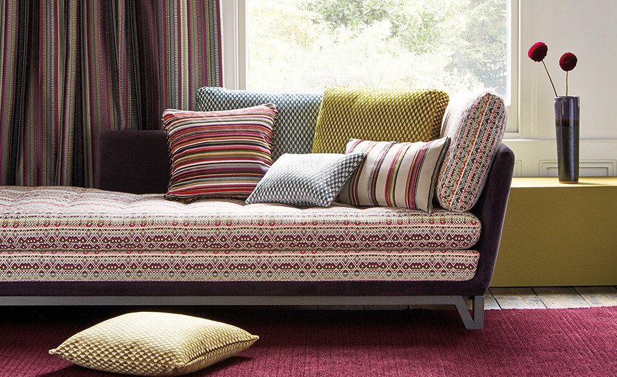 The new Romo collection of fabrics on a sofa and cushions