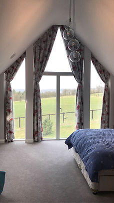 Large bespoke curtains for V shape floor to ceiling windows handmade by Seamsfine