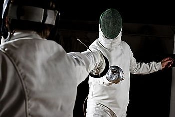 Two epee fencers, fencing is sport for schools and school summer camps