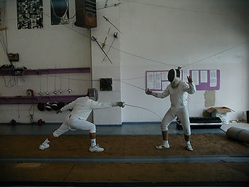 Two epee fencers a sport for school summer camps