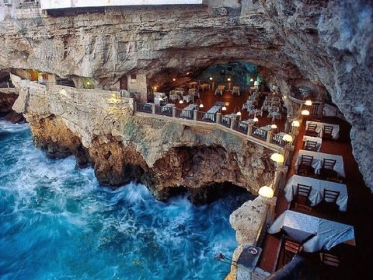 Restaurant in a cave overlooking the sea  organised  for a company event in Puglia, Italy