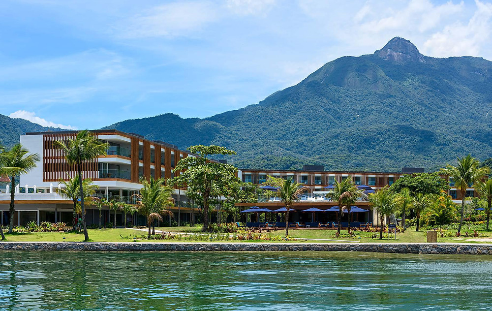 The beautiful front of hotel Fasano between the sea waters and the mountain covered in lushy vegetation of the Atlantic Forest in Angra dos Reis.  Our DMC Brazil loves it.