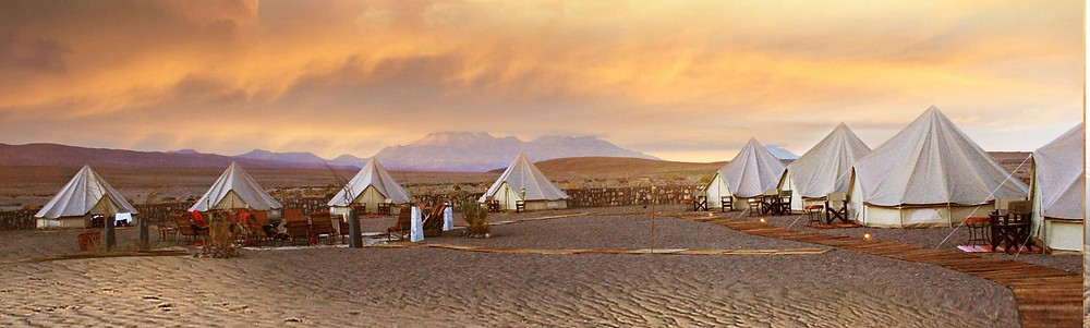 Eight luxurious tends in the Atacama Desert' sunset  where our DMC Brazil offers event management services and incentives