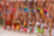 Legs of many Indians in colourful ritual outfits dancing during a ceremony in the Amazon, Brazil where our DMC Brazil and event management and planning agency is based.