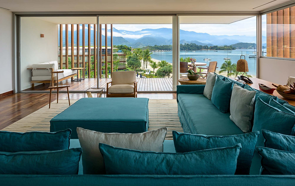 One bedroom of the hotel Fasano in Angra dos Reis, Rio de Janeiro, Brazil with a terrace overlooking the see and the green mountains.