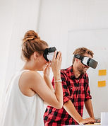 A man and a woman wearing virtual reality headsets during a meeting representing our DMC Brazil and Event Managment services