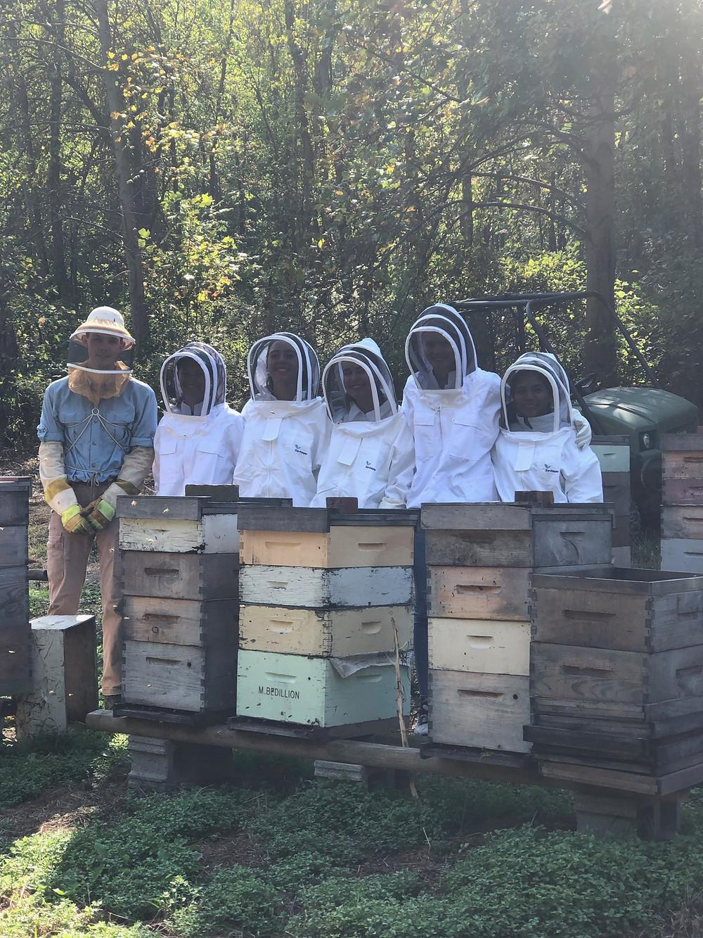 My team members and I alongside Sam Bedillion in his bee yard.