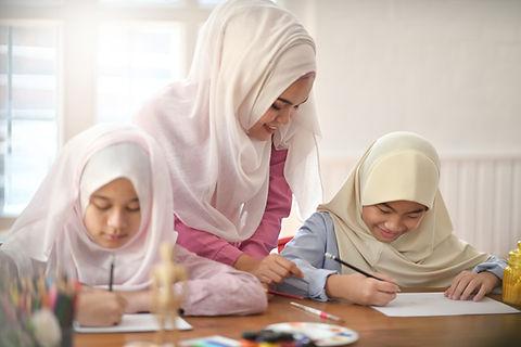 Young Asian muslim female teaching in ar