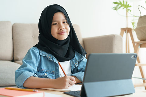 Muslim girl is studying online via the i