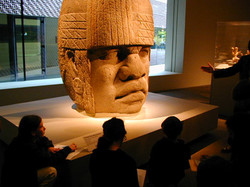sch Olmec Head at deYoung Museum in San Francisco kids taking notes from Docent