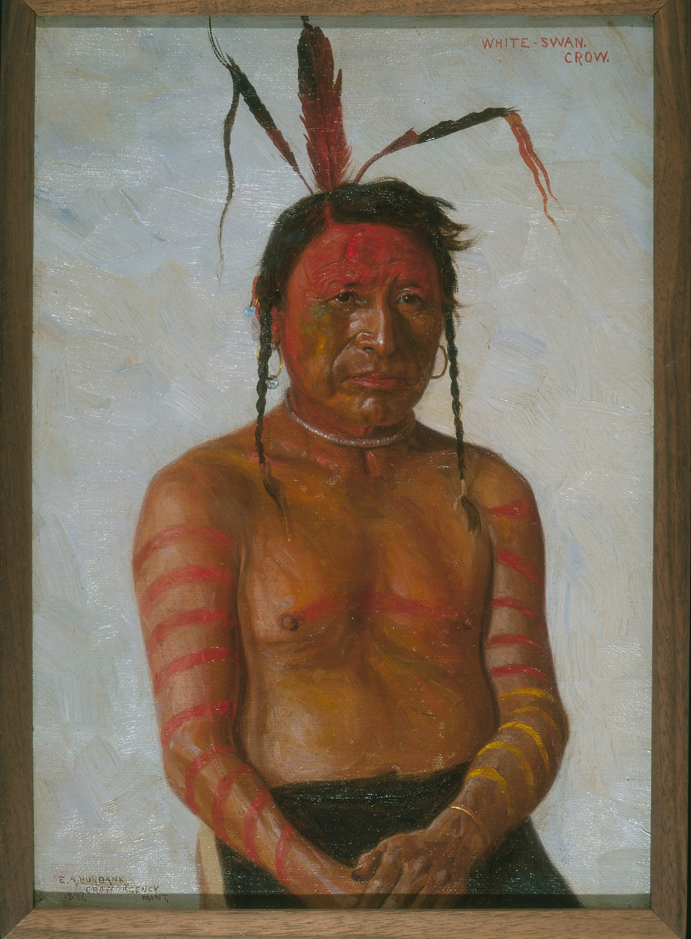 Portrait of a Crow warrior. The three feathers in his hair represent three wounds he received at the battle of Little Bighorn. The red rings painted on his arms represent the number of Sioux he has killed, and the yellow rings represent the number of Chey.