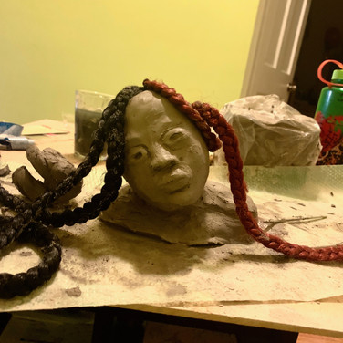 Vera Tineo, Mental Health - Hidden Emotions particularly in Black and Brown Communities, Painted Object Sculpture, clay, hair extensions and paint (in progress)