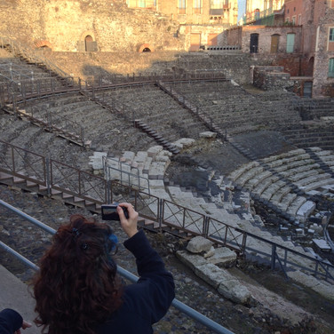 "Catherine de Zagon, ""Meridith with blue hair taking photograph in the Roman Theater in Catania, Sicily"""