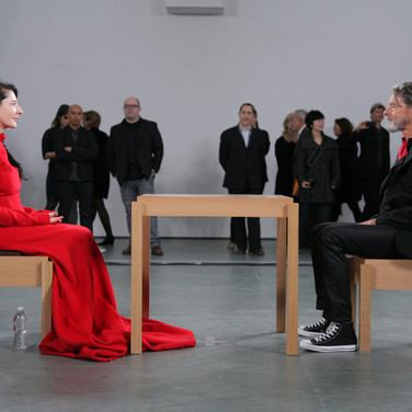 Marina Abramović, The Artist Is Present (2010), Museum of Modern Art, New York. Abramović's former partner Ulay joins her during her performance at her career retrospective.