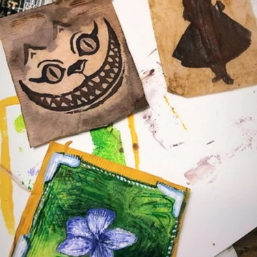 """Jennifer Dodson, """"Paintings on Tea Bags"""", 2020 tea bags. I dry them out and then carefully empty the leaves using an exacting blade. I have been using gouache and watercolor on them to paint things from quarantine, such as the violets I see coming up everywhere and the Cheshire moon 🌙"""