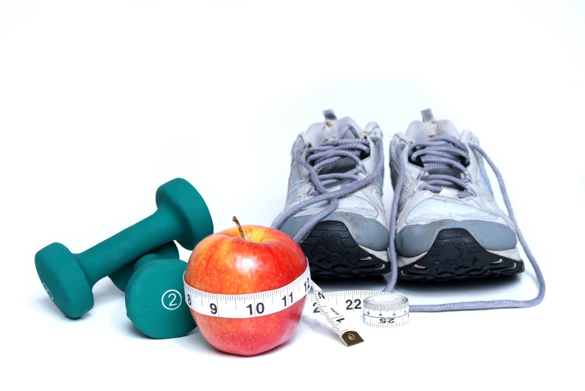 Dumbells, running shoes, apple, measuring tape
