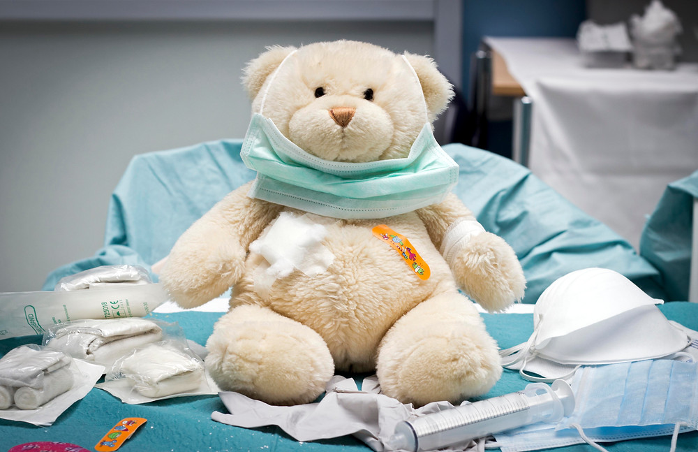stuffed animal bear with medical materials