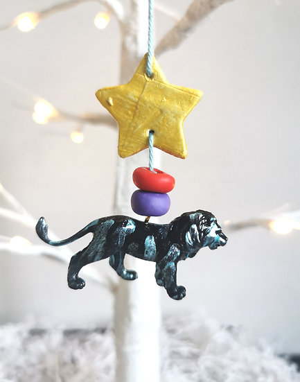 Rewild lion bauble black/purple/red