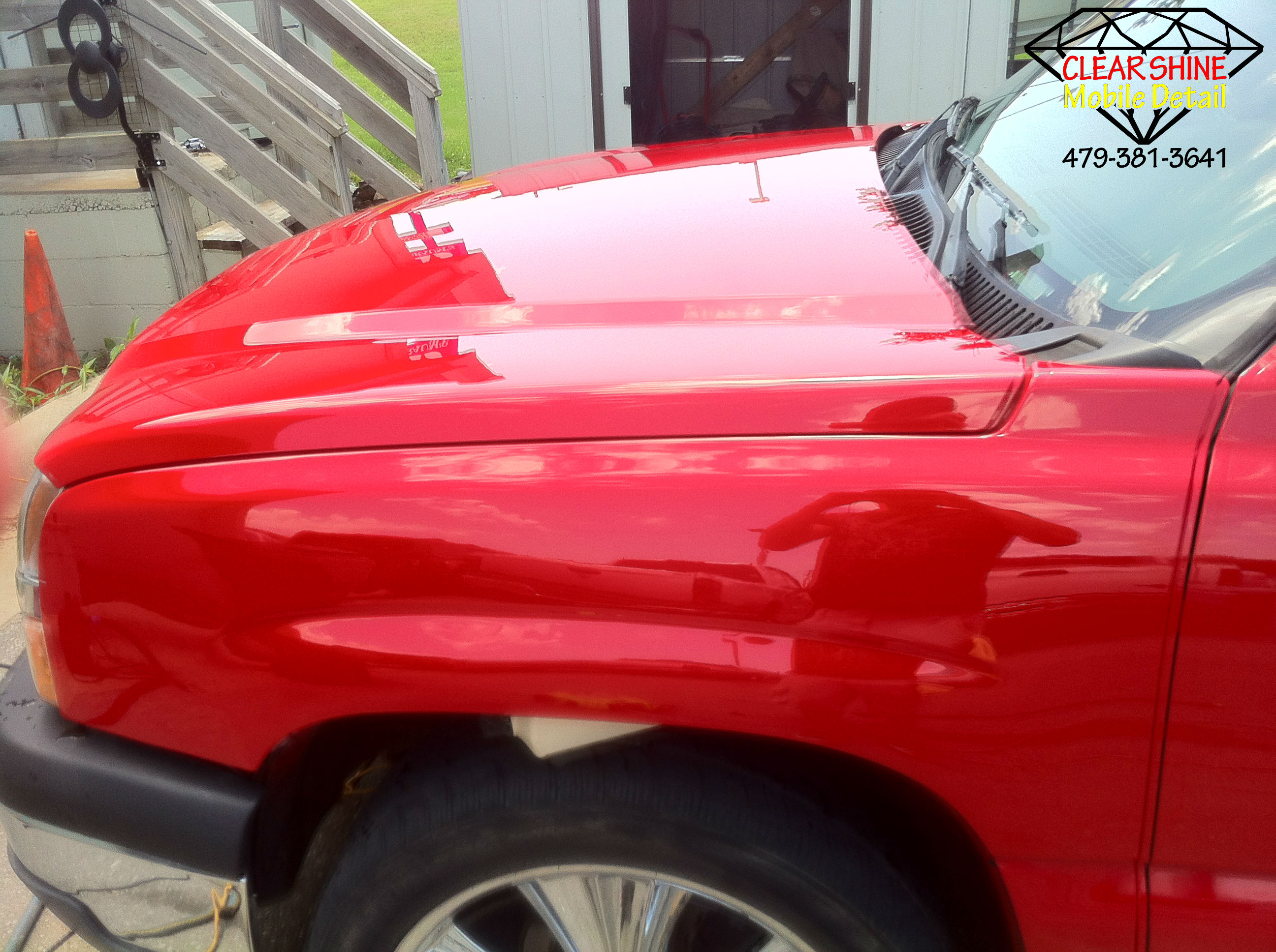 Red Chevy hood paint correction with csmd logo