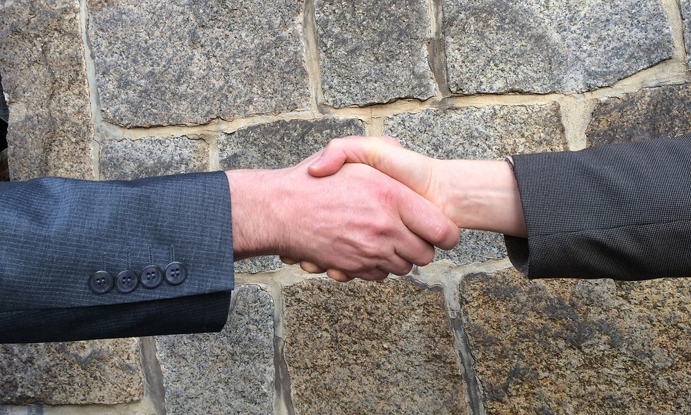 Handschlag Mediation