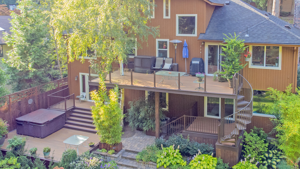 Multilevel Deck with Spiral Staircase & Glass Handrail