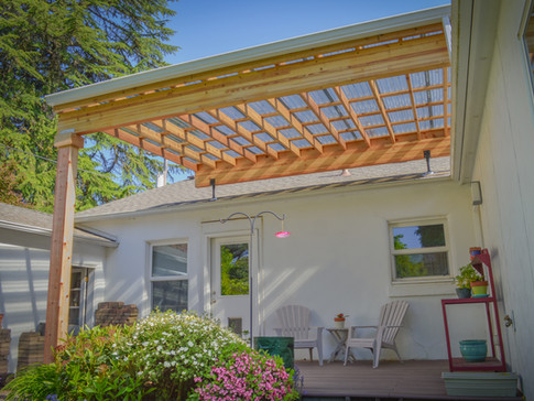 Suntuf Courtyard Patio Cover with SkyLift Roof Risers