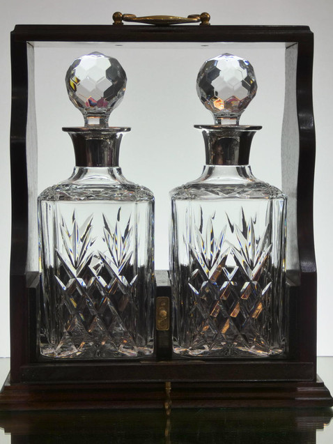 2 english hand made full lead crystal whisky decanters hand cut fitted with solid silver tops in wooden tanterlus £400.00